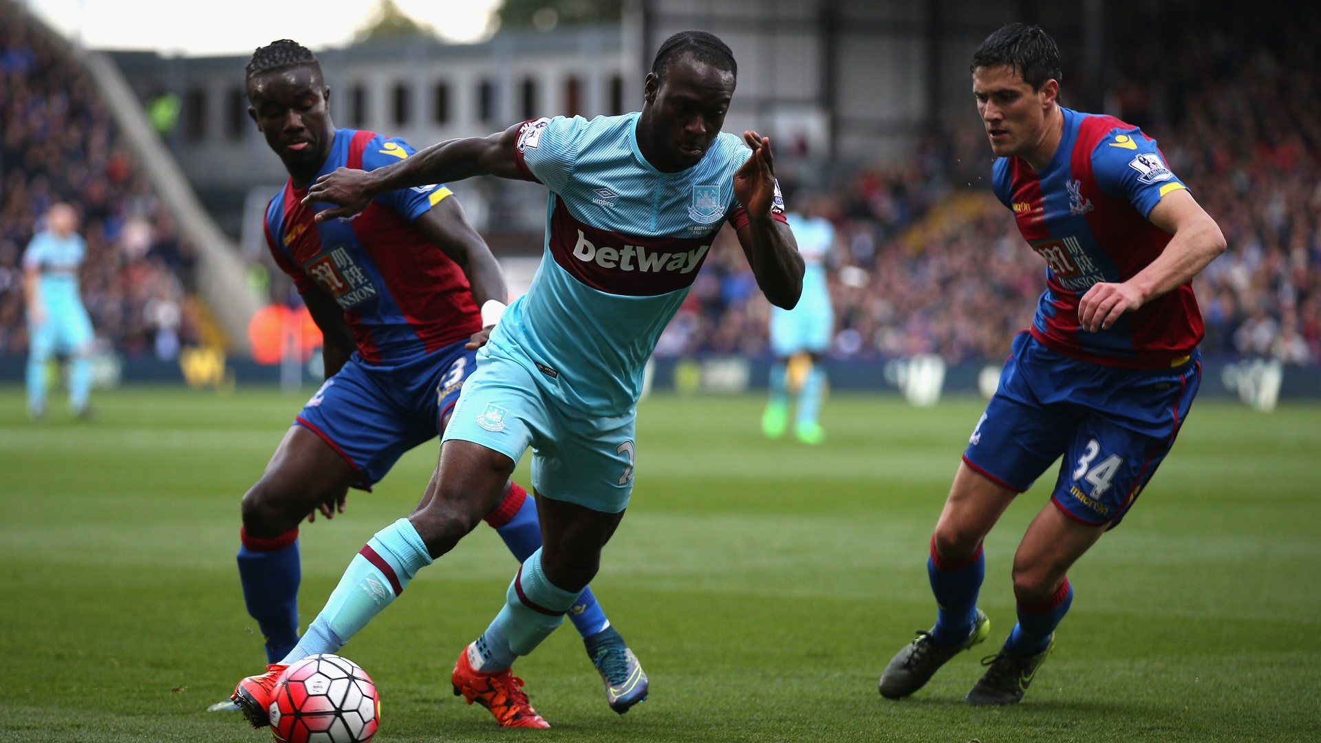 Victor Moses of West Ham United and Martin Kelly of Crystal Palace