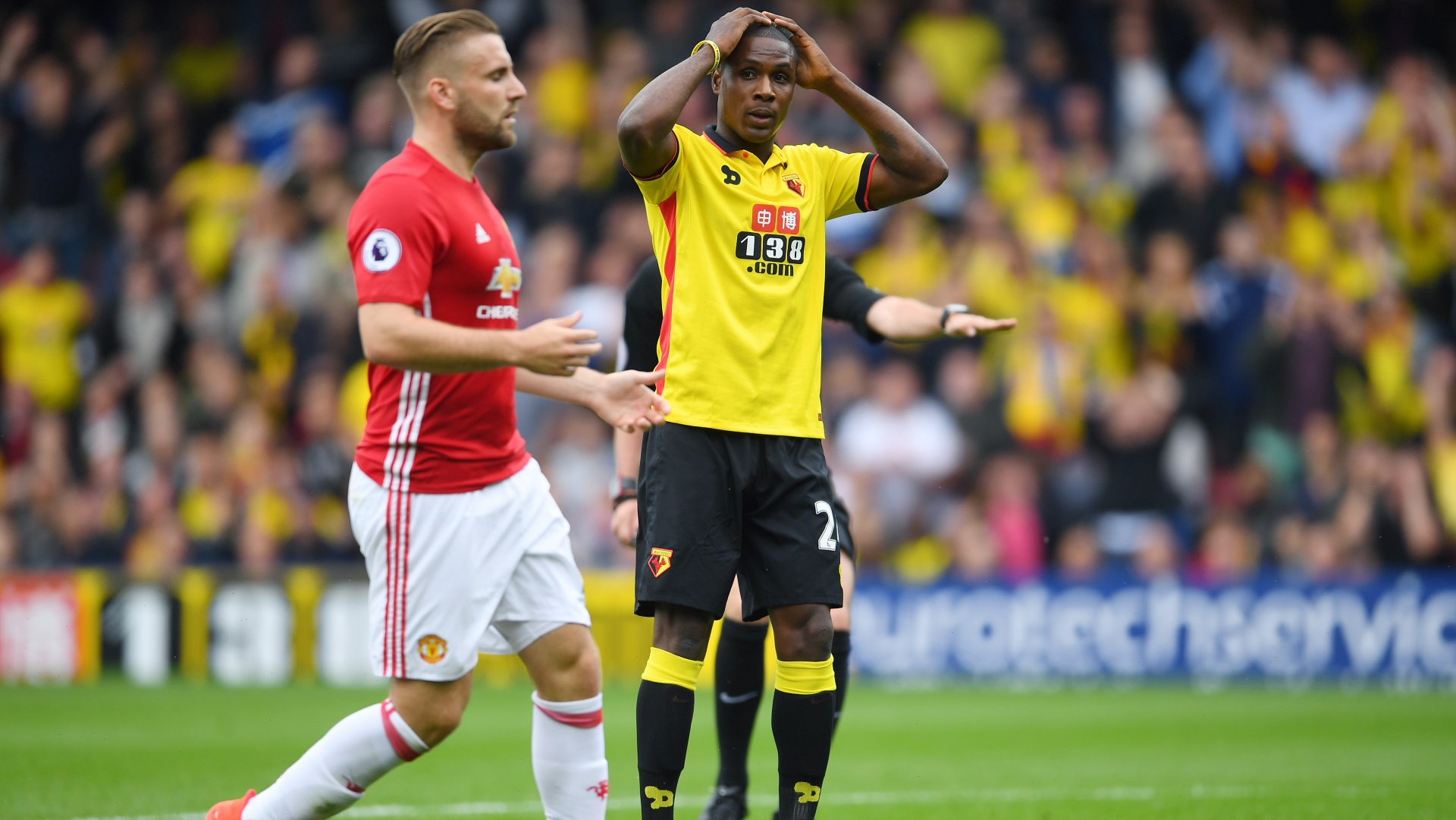 Odion Ighalo of Watford and Luke Shaw of Manchester United