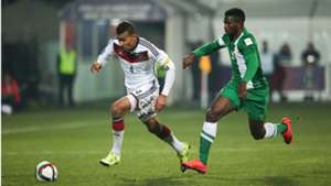 Kevin Akpoguma chased by Nigeria's Isaac Success