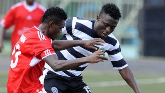 Anthony Okpotu of Lobi Stars & Benjamin Francis of Heartland