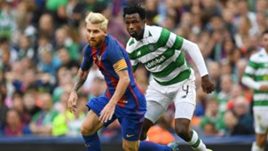 Lionel Messi of Barcelona and Efe Ambrose of Celtic