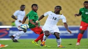 Adams Ahmed of Ghana challenged by Rihno Michel of Madagascar Cosafa Cup 25 May 2015