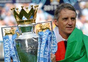Manchester City's Italian manager Roberto Mancini celebrate with the Premier League trophy