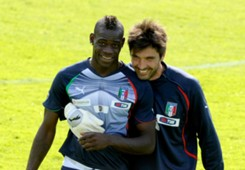 Mario Balotelli and Gianluigi Buffon of Italy