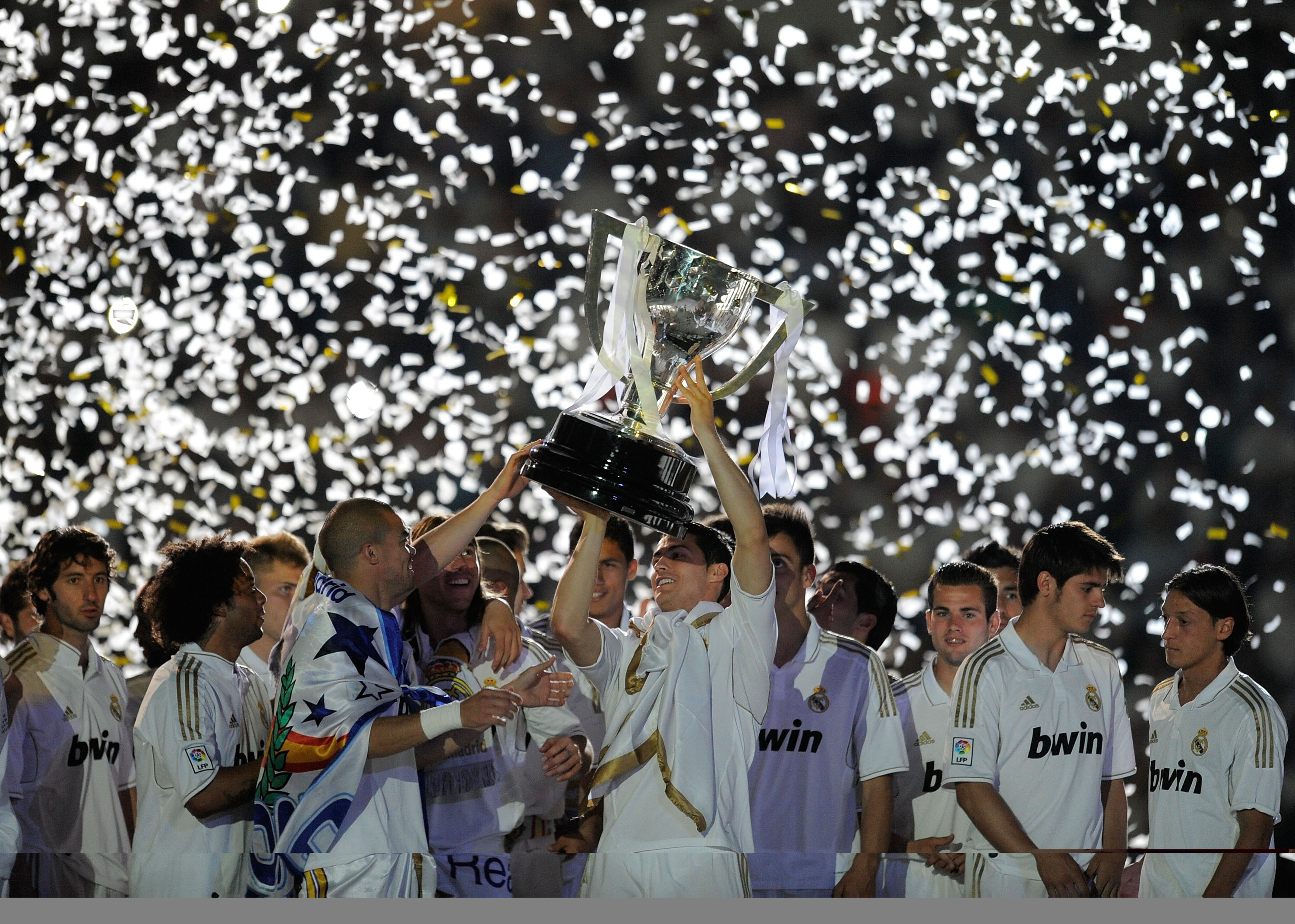 Cristiano Ronaldo of Real Madrid CF holds up the La Liga trophy 2012