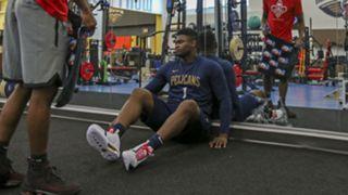 Zion Williamson takes a break during a preseason workout.