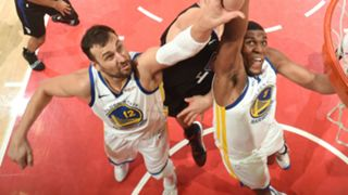 Andrew Bogut and Kevon Looney go up for a rebound during the 1st Round against the LA Clippers.
