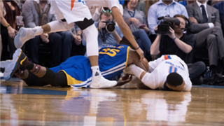 Durant and Westbrook battle for a loose ball during Durant's return to OKC