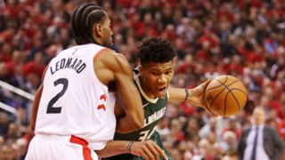 Kawhi Leonard's defends a drive by Giannis Antetokounmpo in Game 4.
