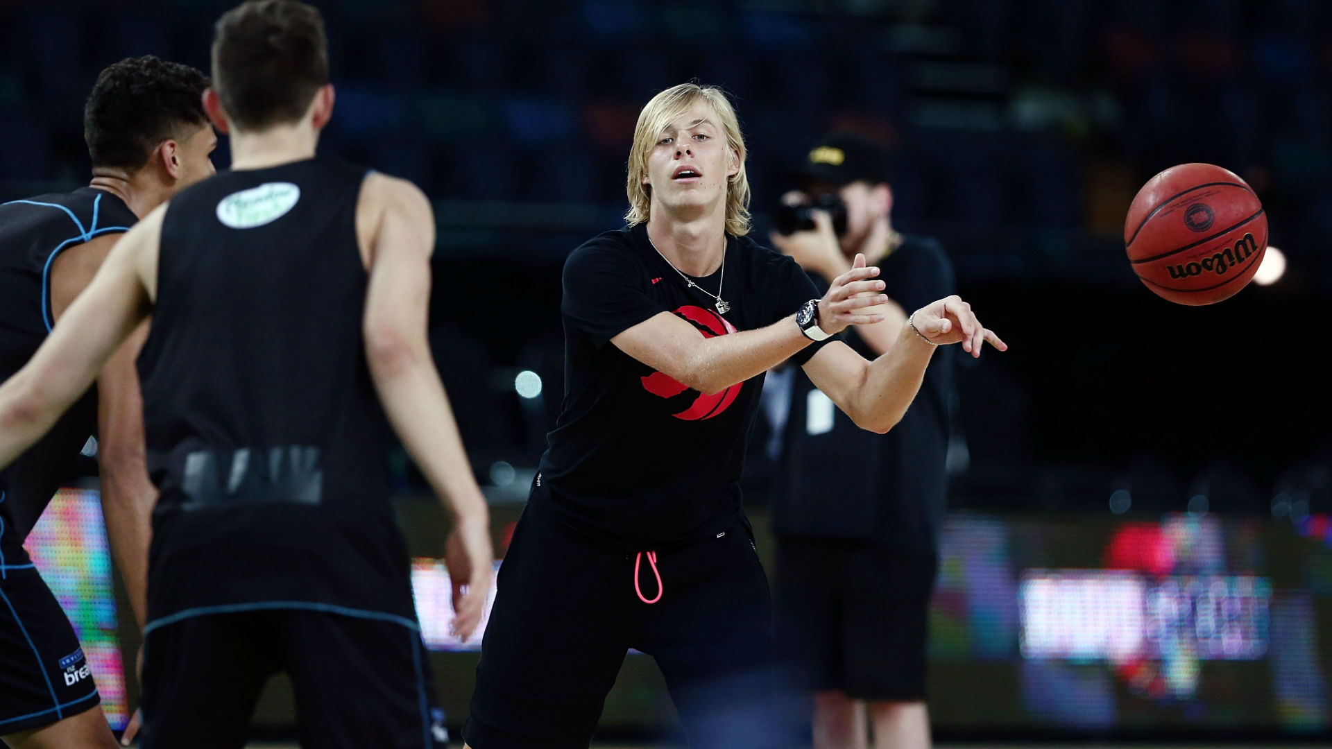 Shapovalov shows basketball skills, moving from hard courts to hardwood for a day