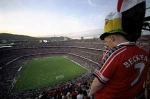 A Manchester United fan watches play in the European Champions League Final against Bayern Munich in the Nou Camp stadium in Barcelona