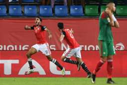 Egypt's midfielder Mahmoud Abdel-Moneim (L) Kahraba celebrates with Egypt's midfielder Mahmoud Hassan