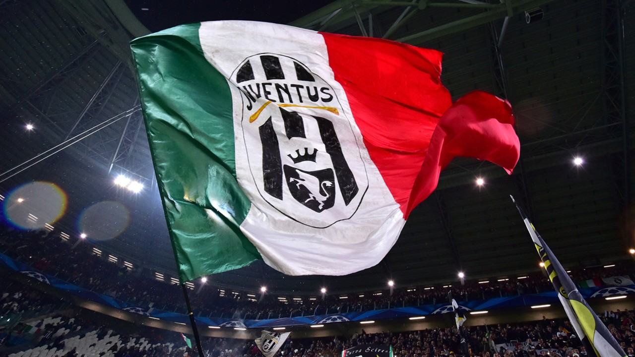 Juventus fans wave a giant flag prior the UEFA Champions League Group A qualifying football match Juventus vs Olympiakos Piraeus at the Juventus stadium 2014