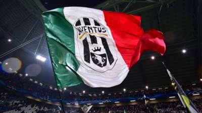 Juventus fans wave a giant flag prior the UEFA Champions League Group A qualifying football match Juventus vs Olympiakos Piraeus at the Juventus stadium 2014