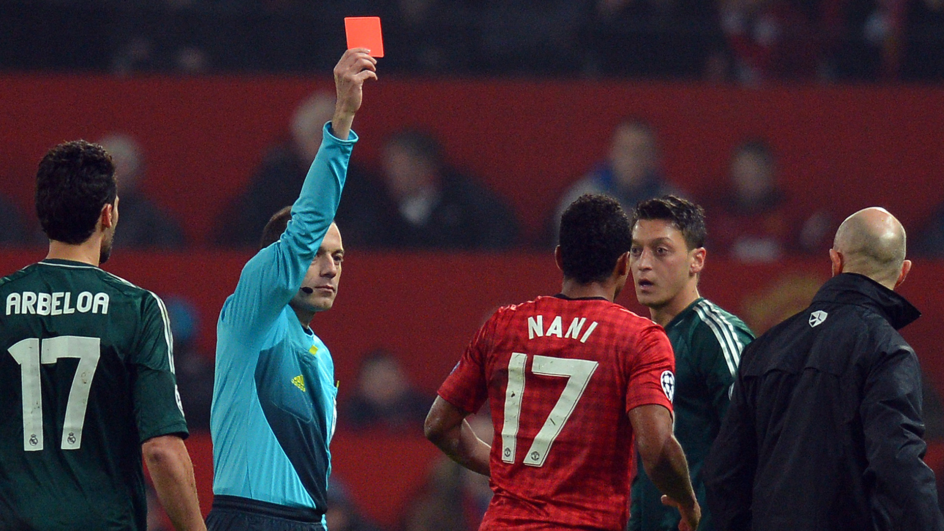 Referee Cuneyt Cakir shows Nani the red card s Nani the red card to send him off during he UEFA Champions League Manchester United and Real Madrid at Old Trafford 2013