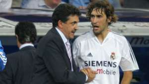 Real Madrid's Raul congratulates team's new coach Mariano Garcia Remon