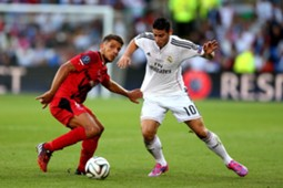 Daniel Carrico of Sevilla and James Rodriguez of Real Madrid