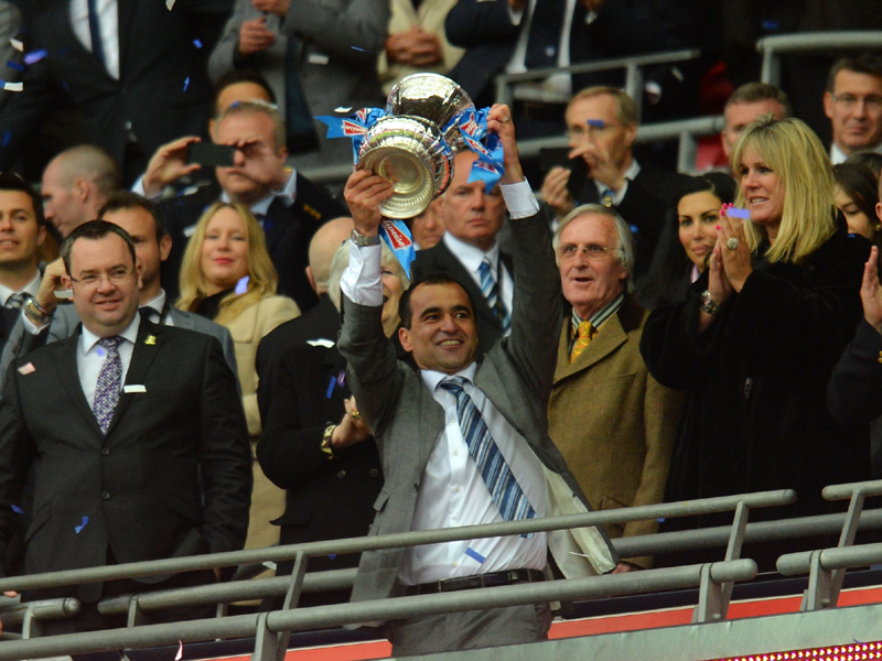 Manager Roberto Martinez of Wigan Athletic lifts the trophy