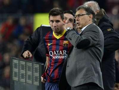Barcelona's Lionel Messi and coach Gerardo Martino