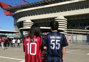 Two Japanese fans in front of San Siro before Ac Milan-Inter
