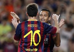 Alexis Sanchez and Lionel Messi celebrate for Barcelona in their friendly against Santos