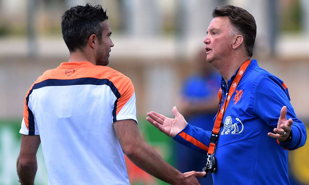 Netherlands' coach Louis Van Gaal and Robin Van Persie