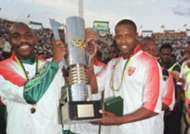 Philemon Masinga and Innocent Buthelezi of South Africa celebrate with the trophy of the Africa Cup of Nations 1996