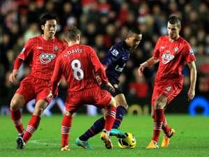 EPL - Southampton v Arsenal, Theo Walcott and Steven Davis