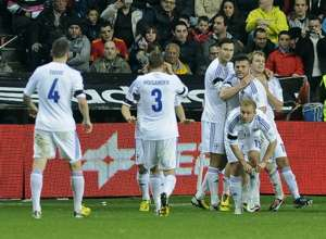 Finland celebrates against Spain
