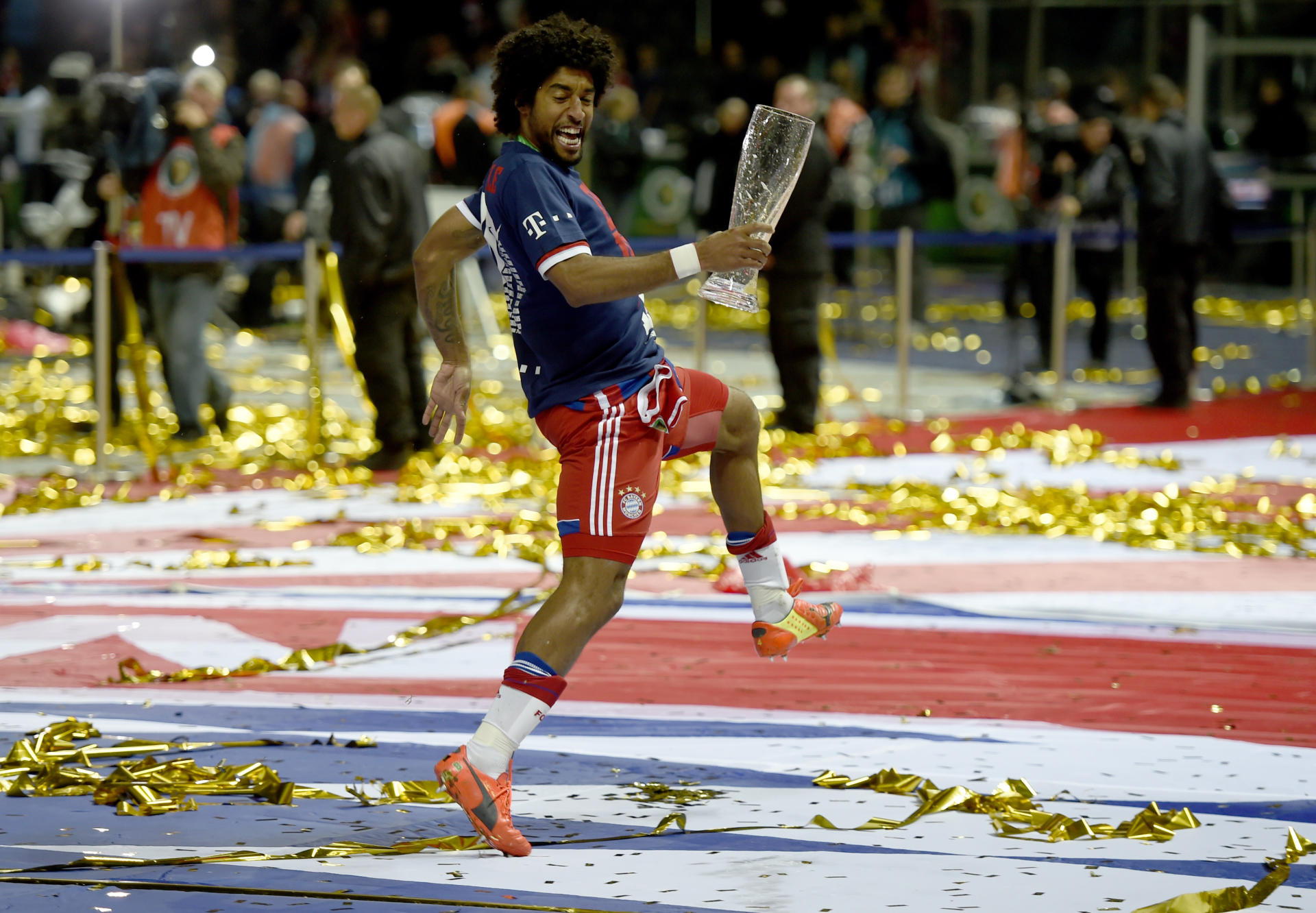 Bayern Munich's Dante celebrates after DFB-Cup win vs Borussia Dortmund