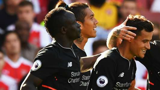 Sadio Mane and Phil Coutinho celebrate