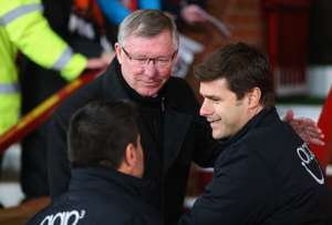 Sir Alex Ferguson manager of Manchester United shakes hands with Mauricio Pochettino manager of Southampton