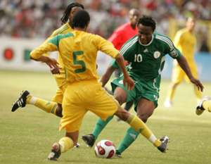 Mikel weaves past South African defenders - South Africa vs Nigeria