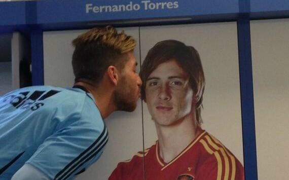 SPAIN: Sergio Ramos kisses Torres poster