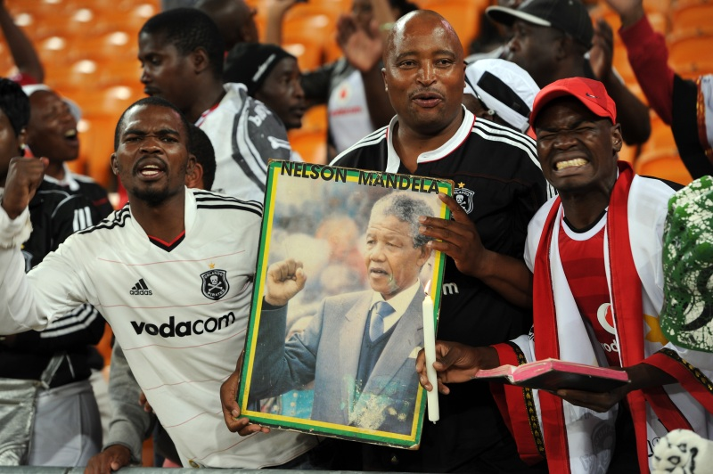 Orlando Pirates fans with Nelson Mandela poster