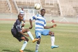Thika's Wycliffe Opondo tries to beat AFC Leopards Abbas Kiwalabye.