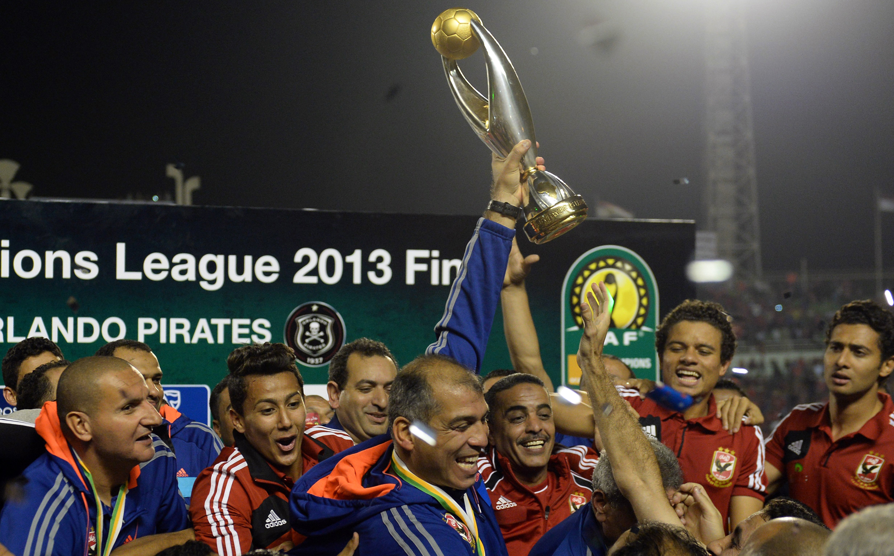 Egyptian al-Ahly coach Mohamed Youssef holds up the African Champions League