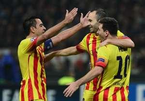 Barcelona's Xavi, Iniesta and Messi