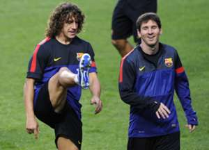 Barcelona's Carles Puyol and Lionel Messi in training