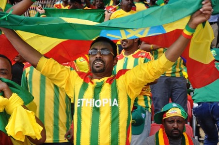 Ethiopia fan waves the national flag Addis Ababa 13102013
