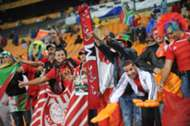 Morocco fans wave their national flag at the start of their match against Angola