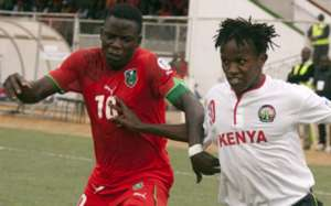Kenyas Nyambula Francis Kahata fights for the ball with Malawis Joseph Kamwendo during their 2014 World Cup Football qualifier match at Kamuzu Stadium in Blantyre