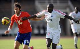 Kenya's Harambee Star's player George Owino (R) vies for the ball against Namibia's Milko Risser on September 6, 2008.