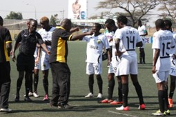 Tusker coach Robert Matano with the squad during match against Mathare..