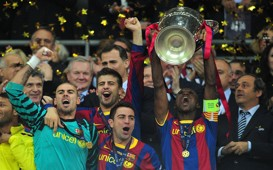 Eric Abidal lifts Champions League trophy (Getty)