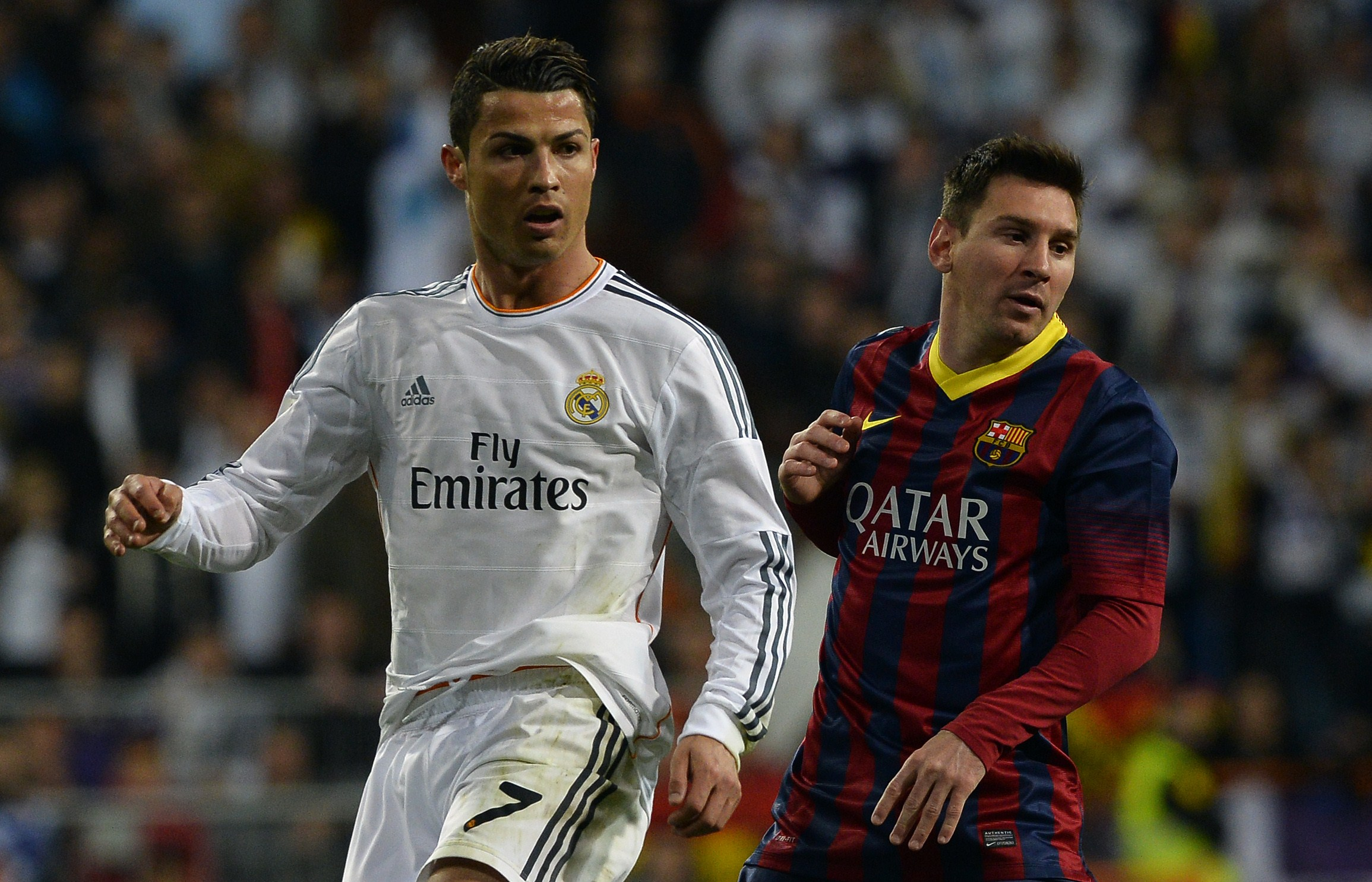 Real Madrid's Cristiano Ronaldo (L) and Barcelona's Lionel Messi