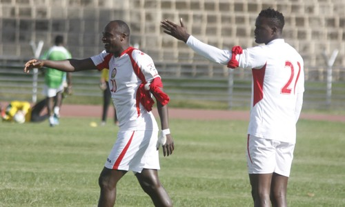 Kenya striker Denis Oliech and Macdonald Mariga