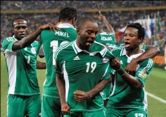 Sunday Mba celebrates opening goal with teammates - 2013 Afcon