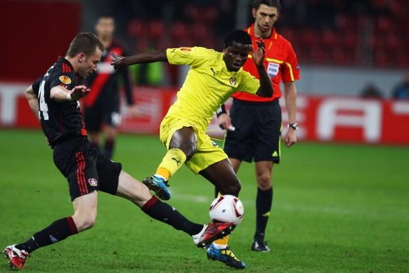 Wakaso Mubarak (R) of Villarreal is challenged by Michal Kadlec of Leverkusen.