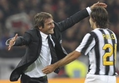 Antonio Conte (l) and Andrea Pirlo (r) embrace